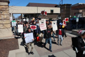 TAA members marching with anti-mandatory-fee signs