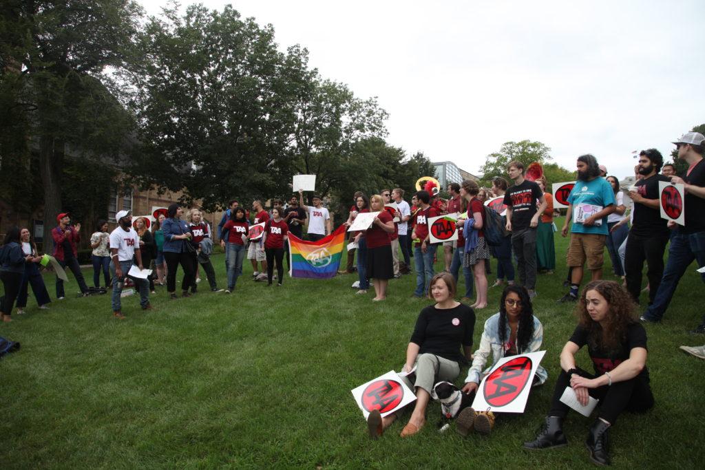 Grad workers on Bascom Hill lawn